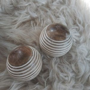 Two farmhouse-style orbs / wooden decorative